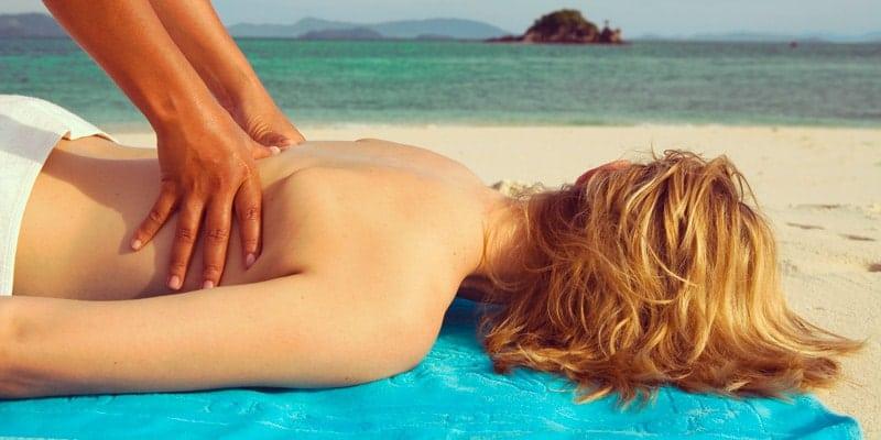 woman-has-massage-on-beach