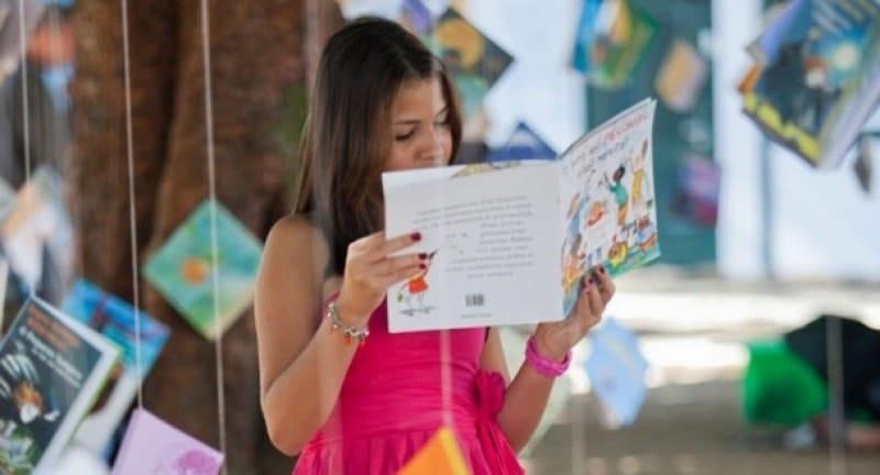 a girl reading books at flipside festival