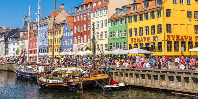 Nyhavn district is one of the most famous landmarks in Copenhagen, Denmark.