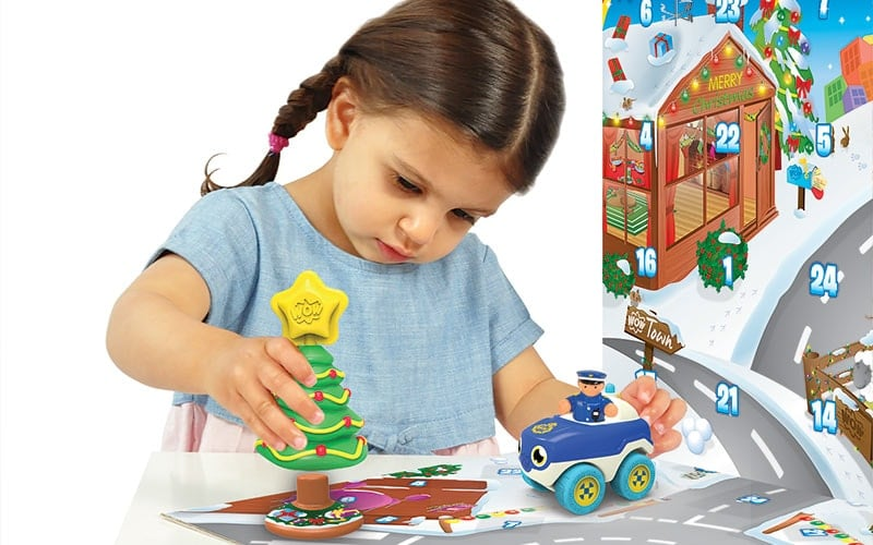 WOW-Toys-girl-playing-with-christmas-advent-calendar - win a competition