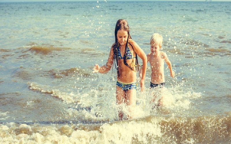 Kids splashing in the sea