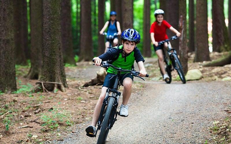 young boy mountain biking