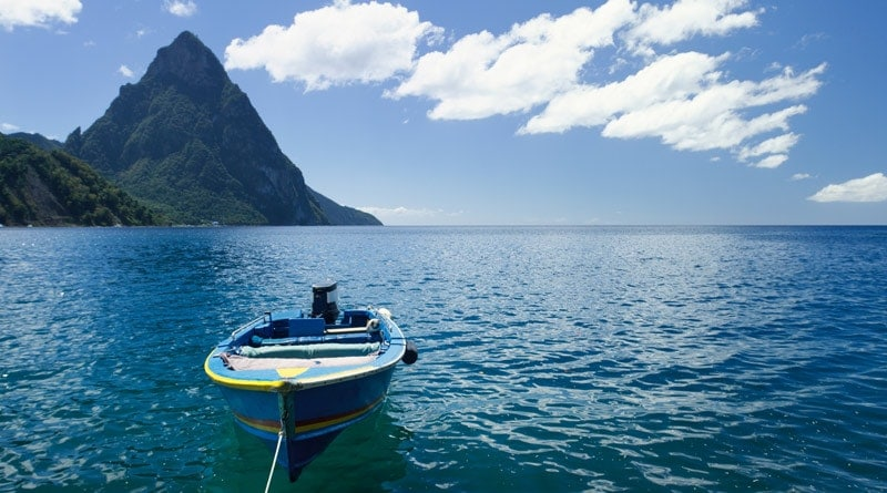 st-lucia-caribbean-boat-on-sea-with-mountains-in-background