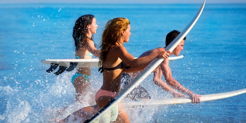 Teenagers surfing
