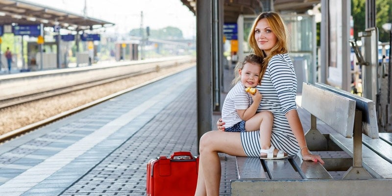 mother-and-child-on-train-station-platform