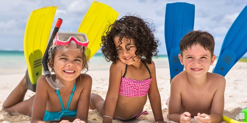 kids-on-beach-in-flippers-mauritius