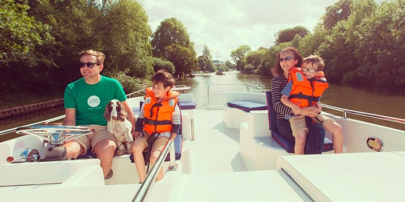 family-with-lifejackets-on-a-boat