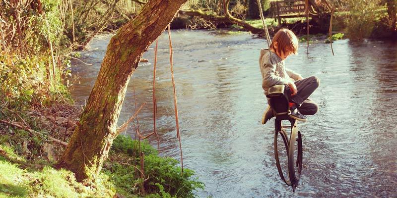 fin-on-rope-swing-over-river-in-devon