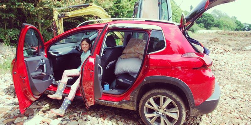 scarlett-standing-by-muddy-peugeot-2008-suv