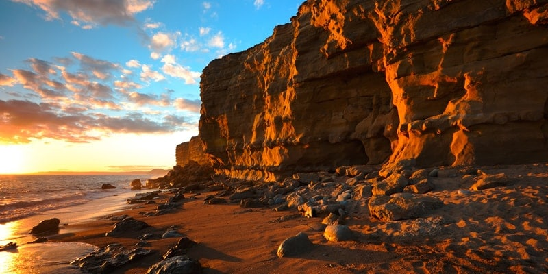 sunset over the yellow cliffs at hive beach