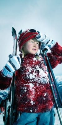 little-girl-in-snow-with-skis-portrait