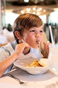 little-boy-slurping-spaghetti-at-tui-discovery-cruise-restaurant