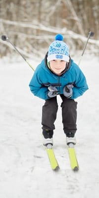 little-boy-skiing-with-poles-portrait