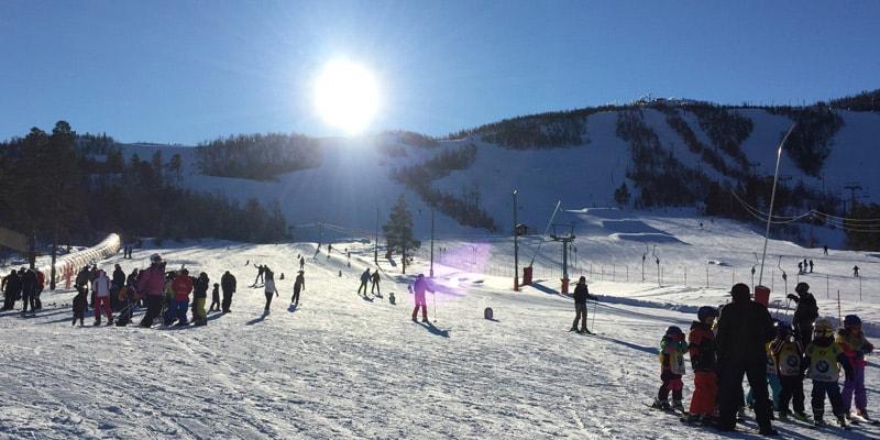 skiiers on mountain geilo norway