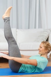 woman-excercising-at-home-on-mat
