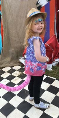little-girl-in-fancy-dress-at-wilderness-festival-portrait