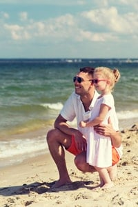 dad-and-young-daughter-on-beach
