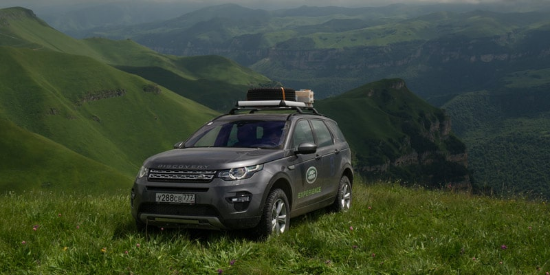 landrover-discovery-sport-suv-on-mountains