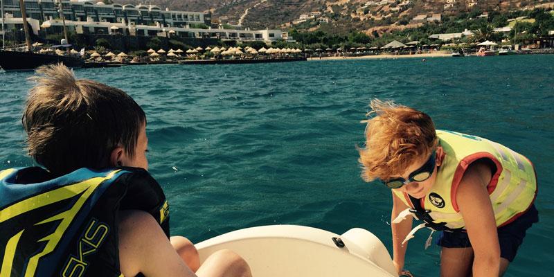 zac-and-friend-on-pedalo-elounda-peninsula-crete