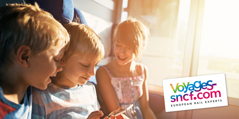 1.-Main-image-Children-with-phone-on-train 2