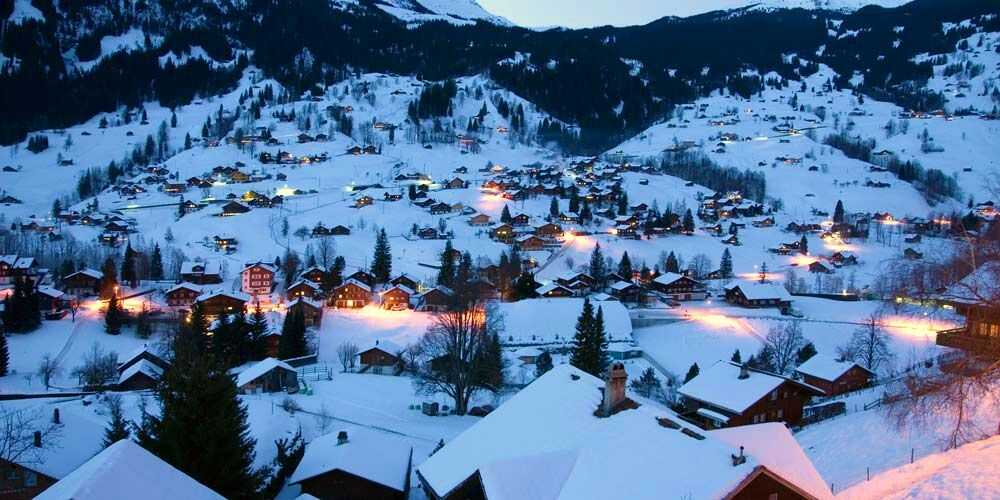 Grindelwald Switzerland snow covered winter village in the Swiss Alps for family holidays