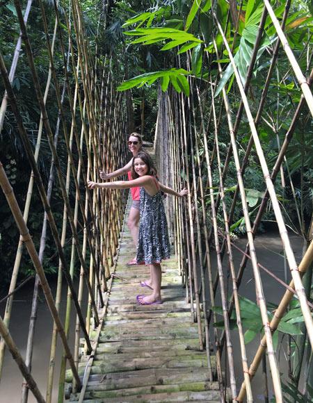 Mother and daughter bamboo bridge - Bali's alternative Green School