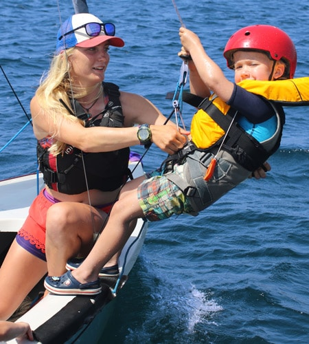Woman and child sailing RYA training courses