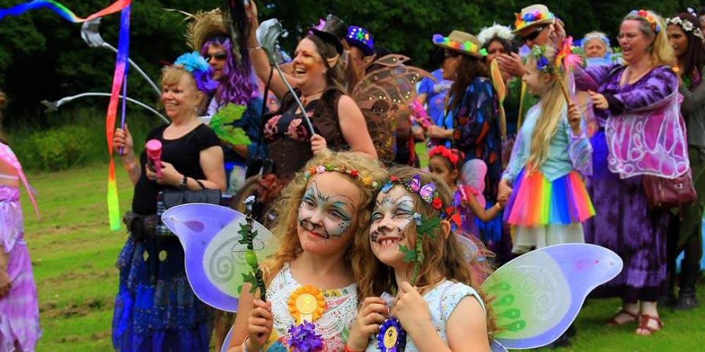 girls in costume - family-friendly festivals in 2018