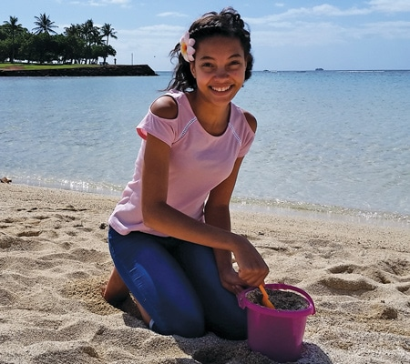 Sophia on beach - island of Oahu in Hawaii