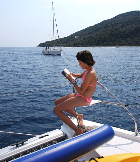 girl reading on boat - Ionian Islands