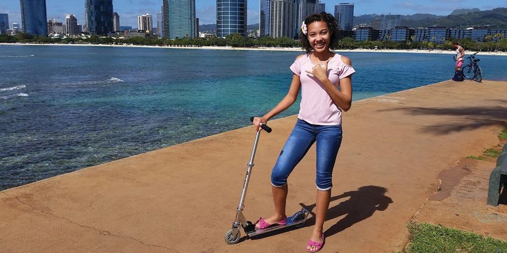 Sophia on scooter - island of Oahu in Hawaii