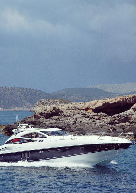 Yacht near coast RYA training courses