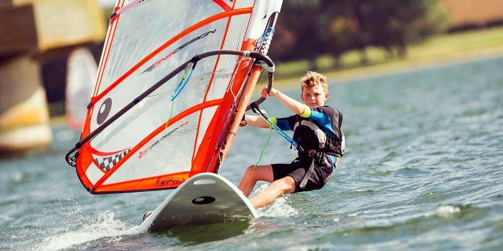 Boy windsurfing RYA training courses