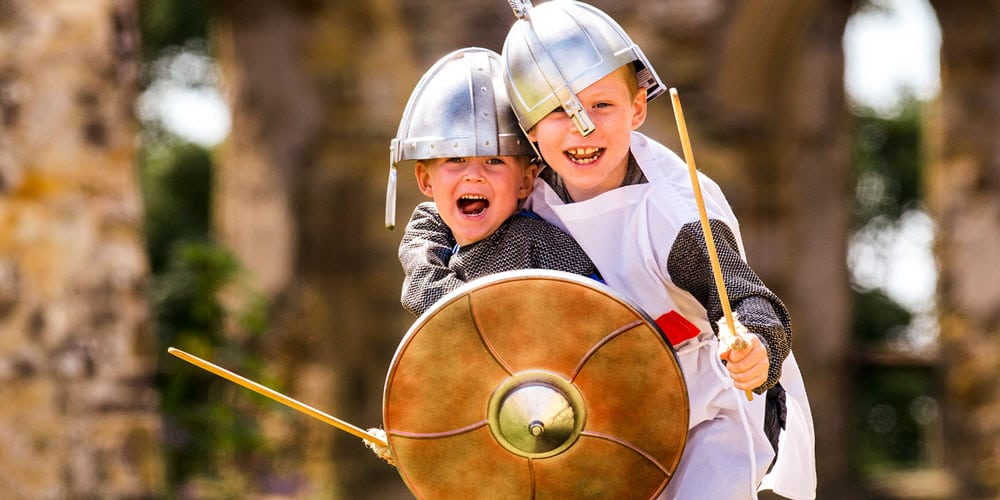 boys in roman costume - things to do in June