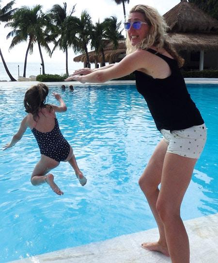 Tracy pushing daughter into water Sugar Beach
