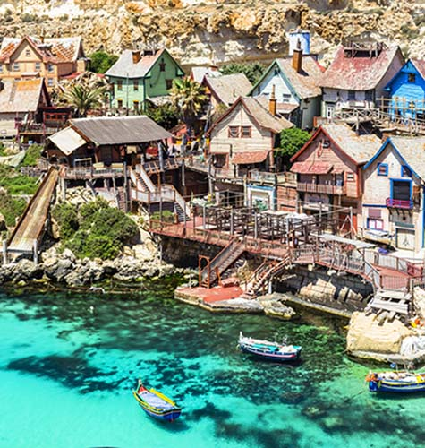 Popeye's Village sits over beautiful turquoise waters in Anchor Bay
