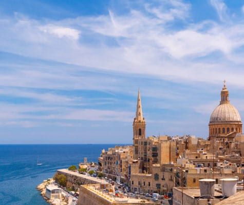 View from above of the domes of churches and roofs with church of Our Lady of Mount Carmel and St. Paul's Anglican Pro-Cathedral, Valletta, Capital city of Malta