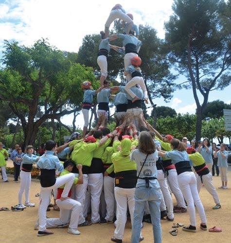 Catalan castellers form a human tower in Sant Feliu, Costa Brava
