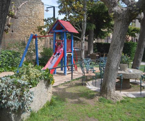 Costa Brava, girl on slide