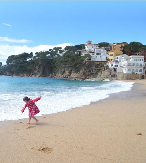 Beach fun on the coast of Sant Feliu de Guixols, Costa Brava