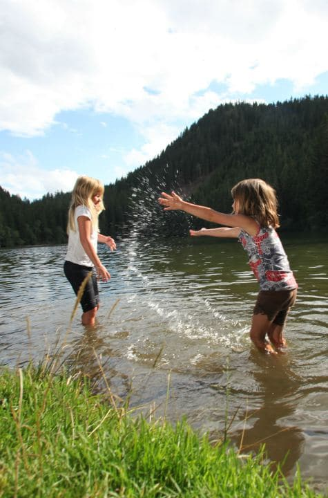 Family holiday in Austria, children playing in river, Austria