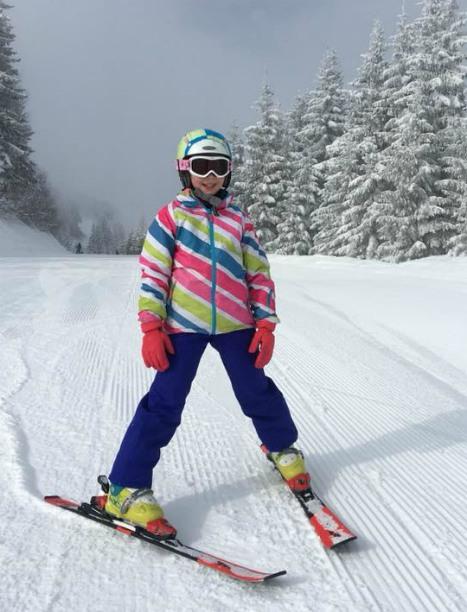 Tips for family skiing, Girl snowploughes on slopes