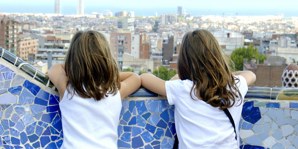 Best family destinations in Spain, children look out over Barcelona from Park Guell