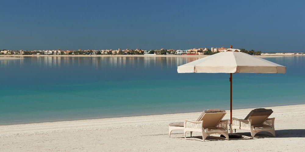 Dubai family holidays Waldorf Astoria Dubai Palm Jumeira private beach with sun loungers