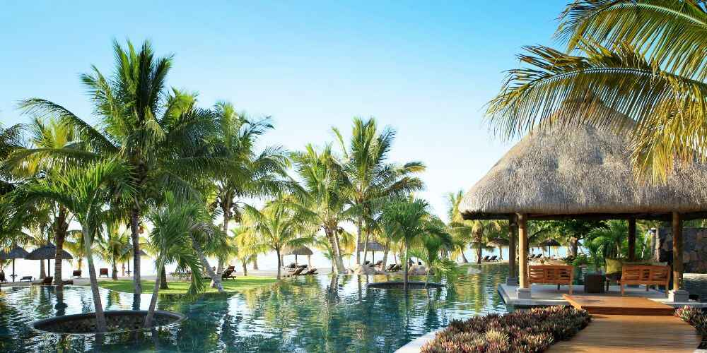 Mauritius family holidays LUX Le Morne Resort pool with Indian Ocean views