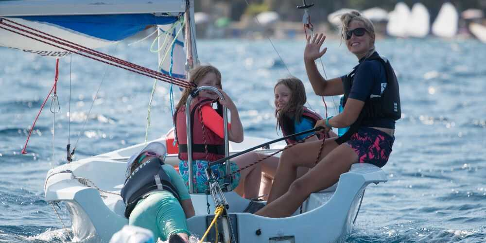 family sailing holidays at Nikiana Beach Club on Lefkada kids with sailing instructor Lefkada Greece