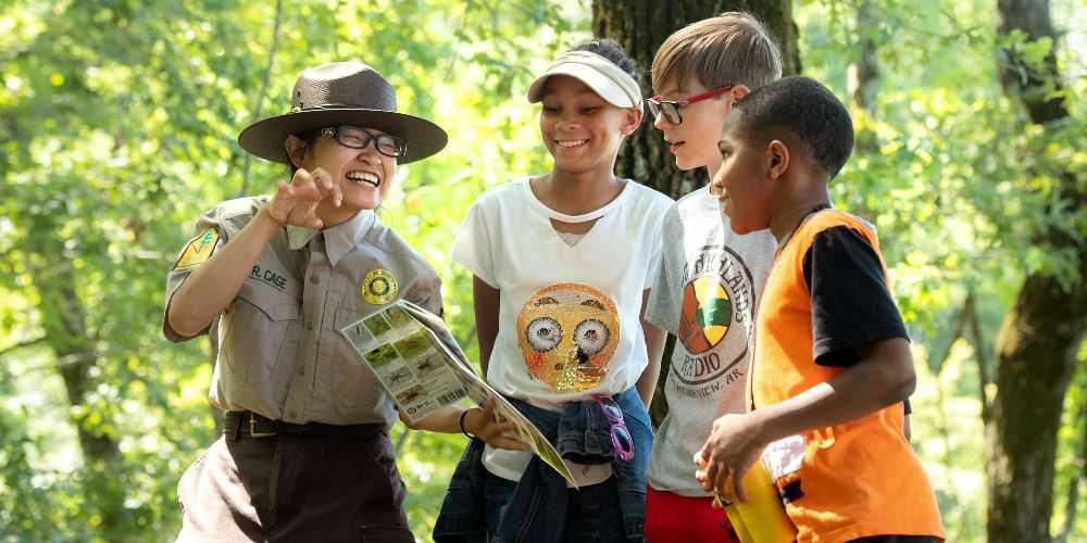 Arkansas family road trip kids and ranger in Cane Creek State Park Arkansas